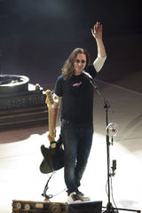 rush, geddy lee, in concert, performing, rock concert, time machine tour, 2010, adieu, farewell, waving goodbye, fender, bass guitar