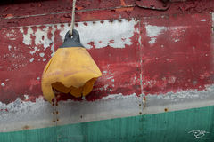 paint; rust; abstract; bow; hull; ship; boat; buoy; broken buoy; damaged buoy; peeled paint; weathered; green; red