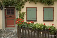 germany, Häuschen, Cottage, medieval, village, town, bavaria, windows, door, red door, green windows, flowerboxes, flower boxes, beige walls, romantische strasse, romantic road, architecture