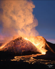 An Icelandic volcano erupts under a colourful sunset