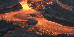 A long exposure of a flowing lava river