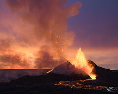 The Fagradalsfjall  volcano erupts in Iceland beneath a colourful sunset