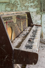 chernobyl, chornobyl, pripyat, exclusion zone, abandoned, forgotten, wasteland, radioactive, decay, peeling paint, reclamation, dusty, wood, piano, green, dust bunny, keys, dust, dirty, weathered