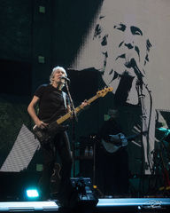 roger waters, pink floyd, in concert, performing, us + them, us and them, bass guitar, dark side of the moon, the wall, scowl