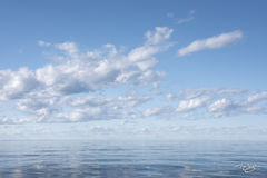 clouds, sea, water, ocean, blue sky, peace, calm, tranquility, smooth seas, calm, calming, tranquil, at ease, skyscape, lake superior, great lakes