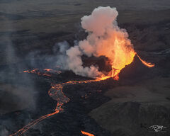 Erupting volcano and lava river in Iceland