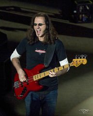 rush, geddy lee, in concert, performing, rock concert, time machine tour, 2012, soloing, fender, bass guitar, growl, snarl, mouth open