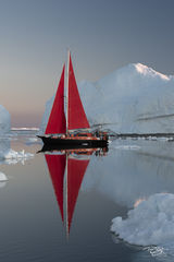 reflection; golden light; golden hour; pastel sky; scarlet sails, ship; sailboat; sailing; red sails; schooner, ice; iceberg; disko bay; dawn; sunrise; early morning, yacht