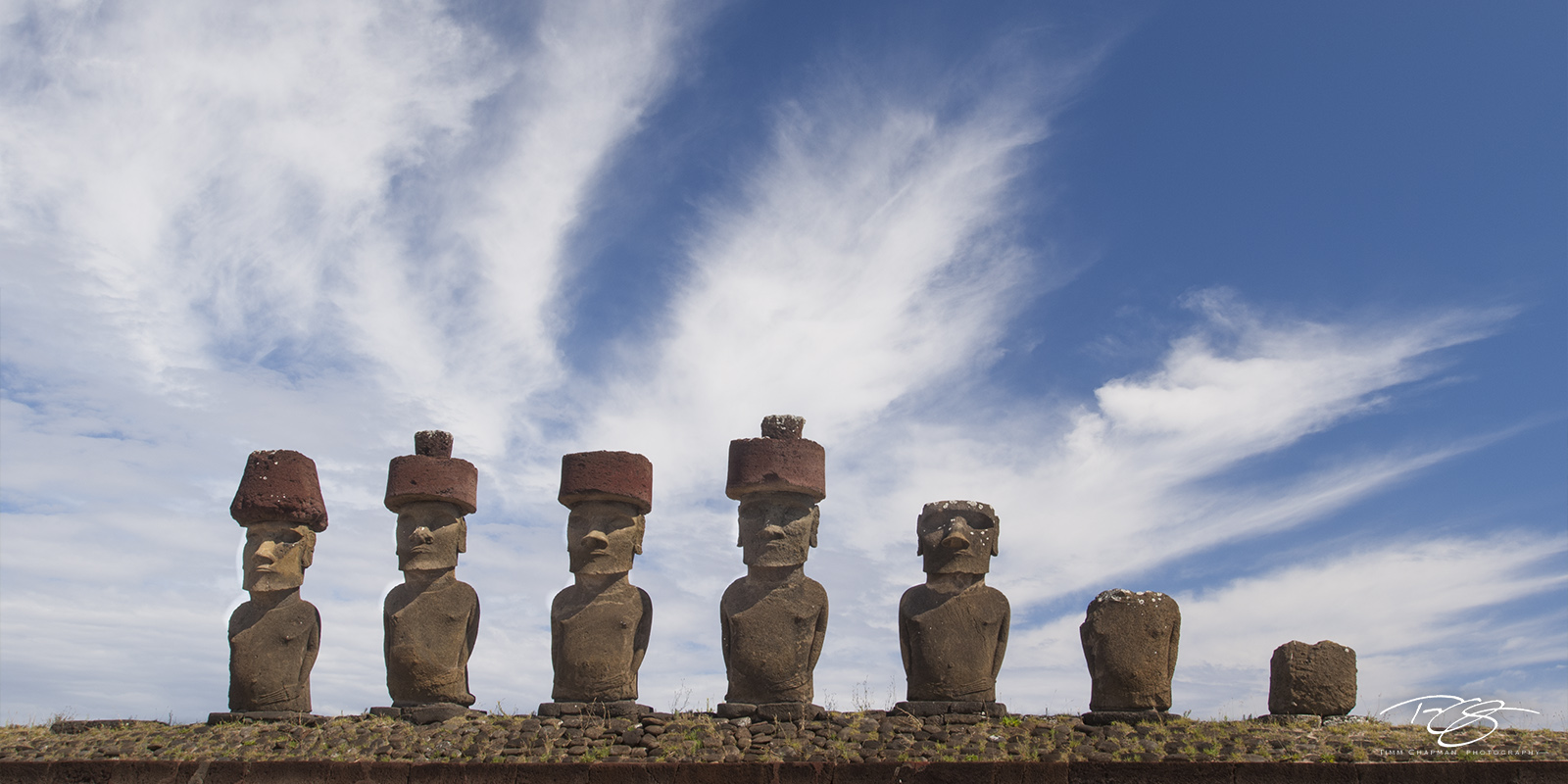 rapa nui, topknot, easter island, red scoria, clouds, whispy, ahu nau nau, isla de pascua, chile, moai, rano raraku, stone statues, giant heads, pop culture, hand carved heads, giant faces, long ears,, photo