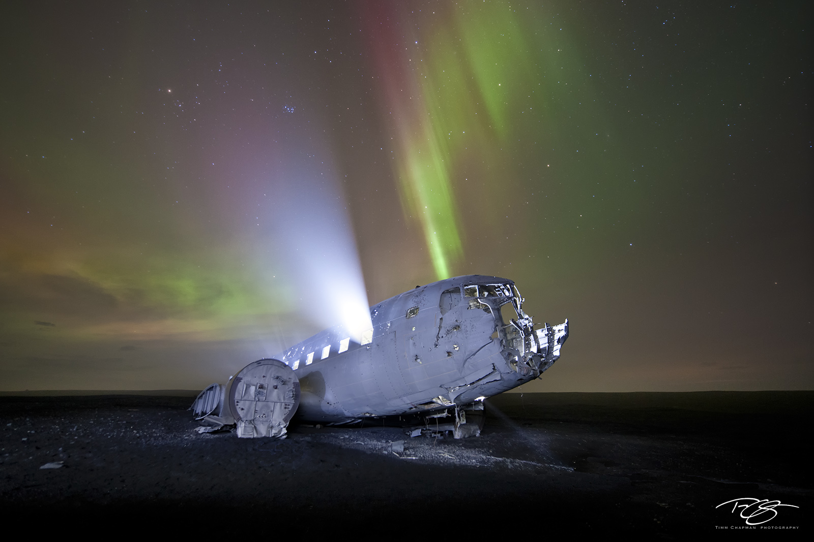 Iceland, aurora, borealis, plane, plane crash, aircraft, dakota, dc-3, apocalypse, apocalyptic, fuselage, light, green, red, stars, northern lights, spooky, spirit, ghostly, souls, haunted, photo