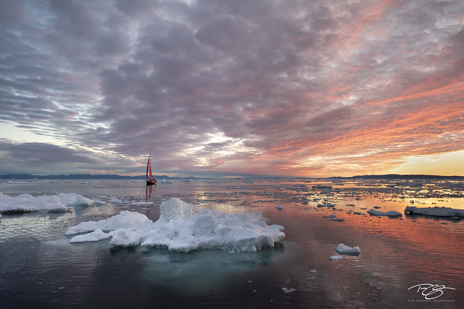 ice; iceberg; disko bay; dusk; twilight; predawn; sunrise; icefjord; ship; sailboat; sailing; schooner; sails; red sails;  scarlet sails