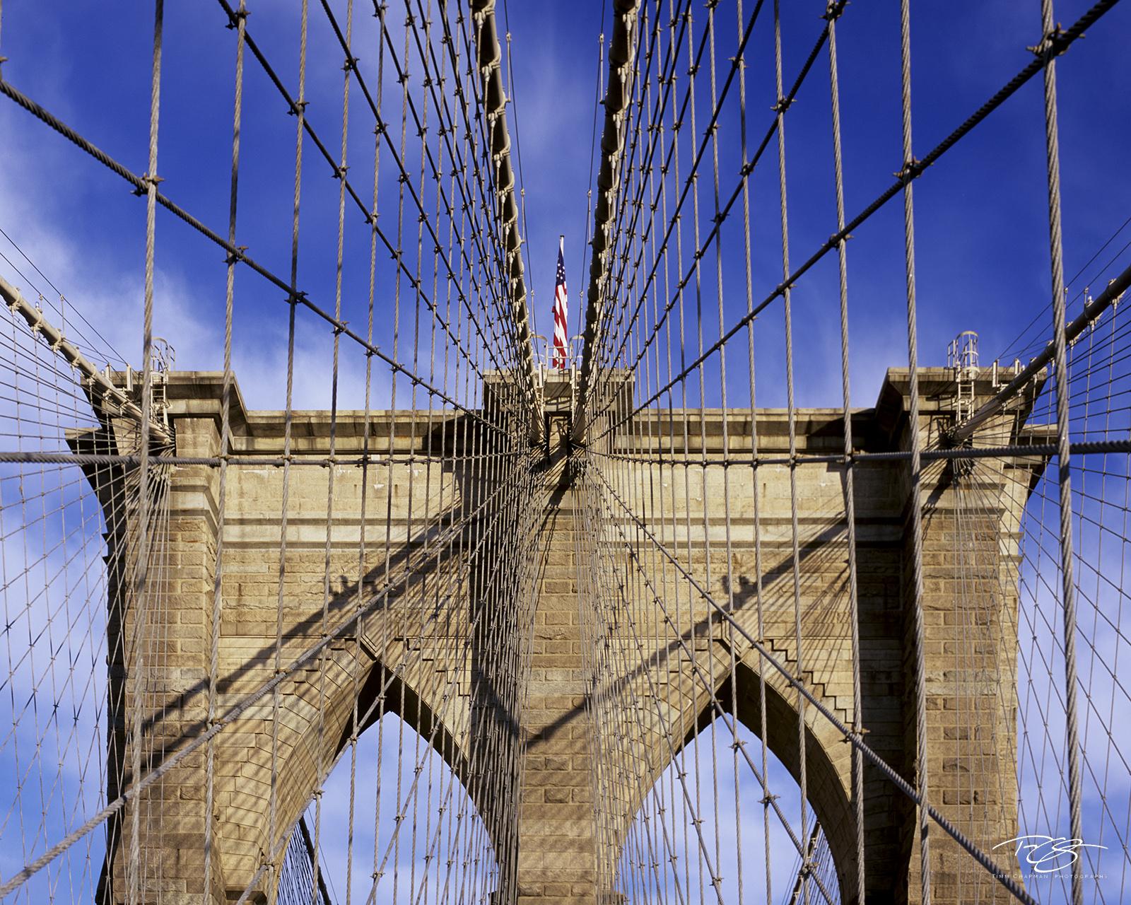 New York, NYC, New York City, Lower Manhattan, Brooklyn Bridge, suspension bridge, cable, stone, wire, flag, architecture architectural detail, bridge, photo