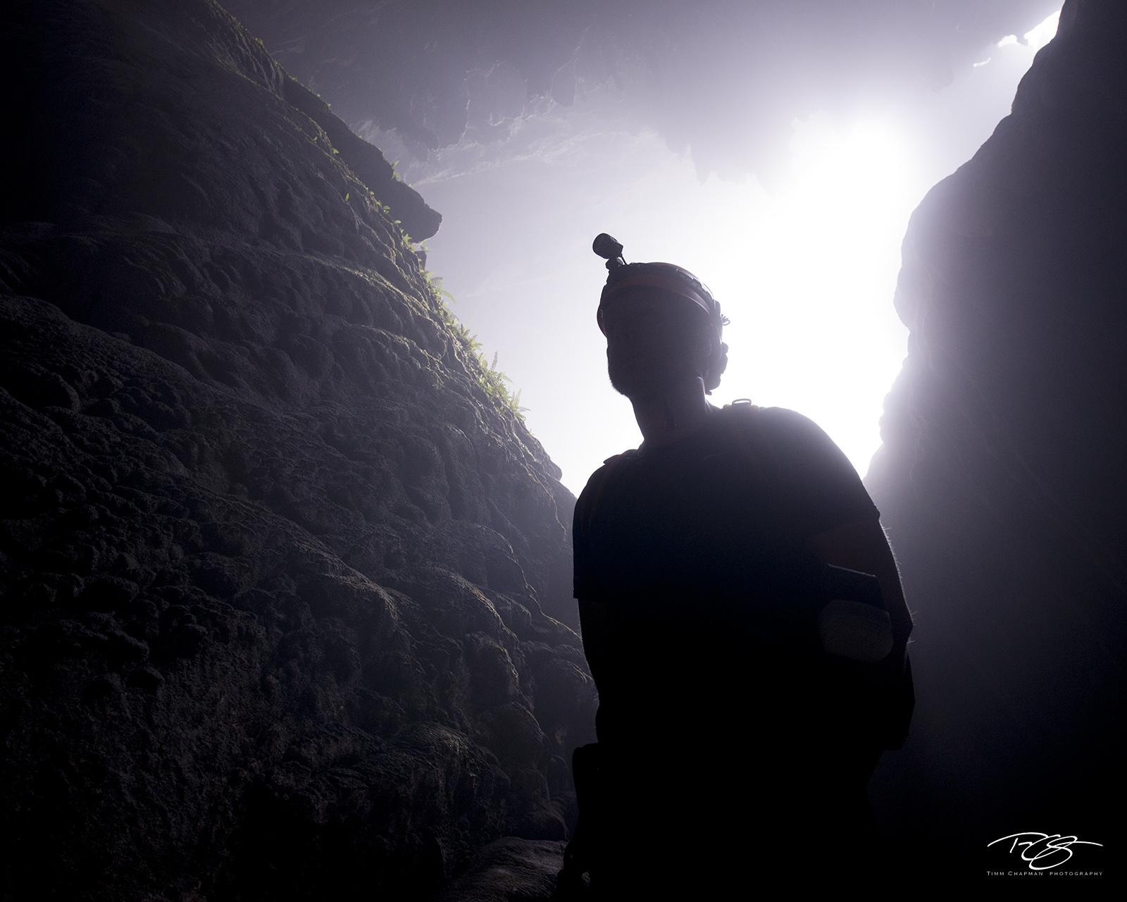 An explorer prepares to descend into the mouth of Hang Son Ðoòng