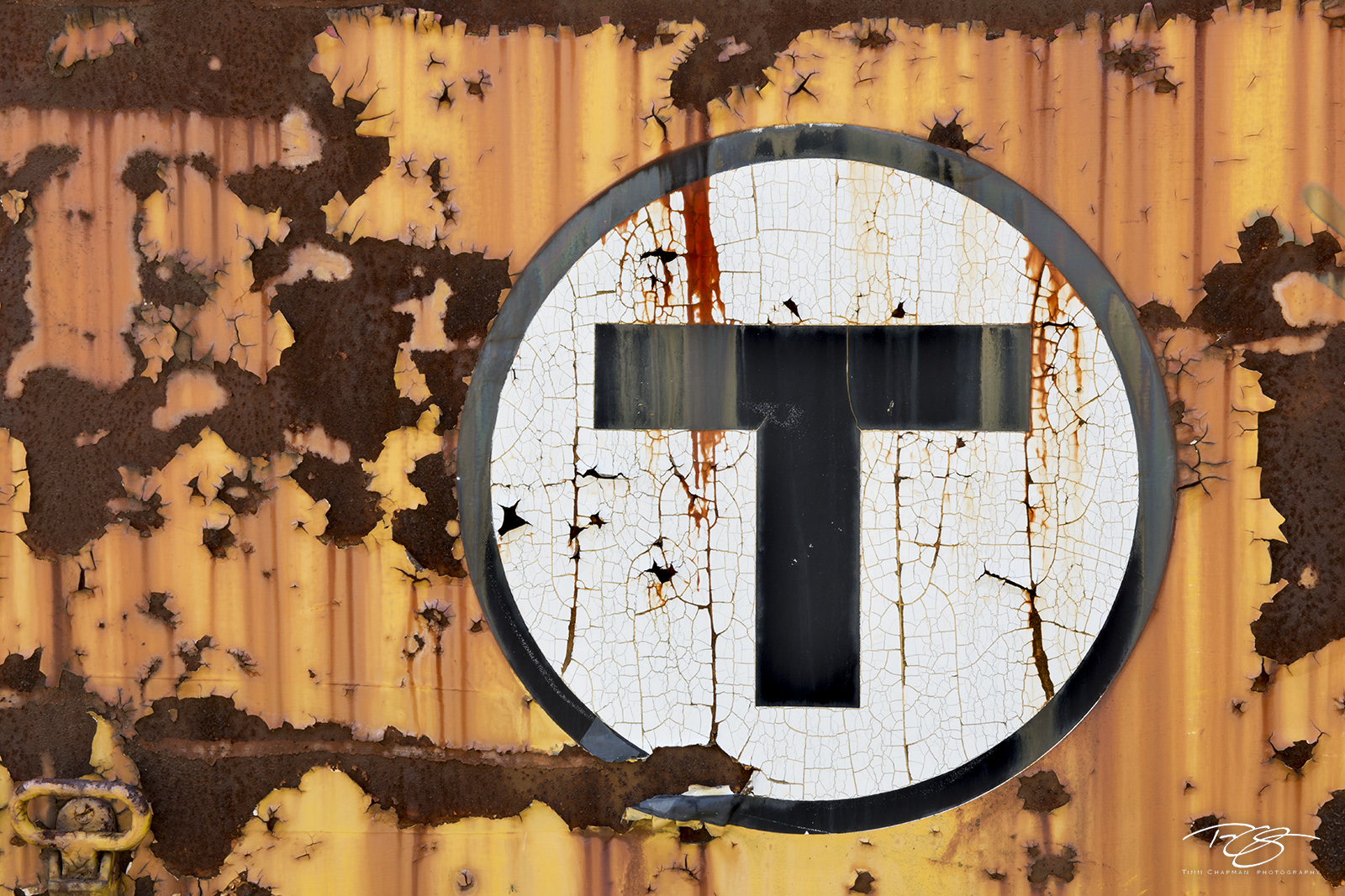 abandoned, trolley car, steetcar, circle T, Massachusetts Bay Transportation Authority, mbta, logo, rust, train, orange, black, white, rusting, peeeling paint, abstract, photo