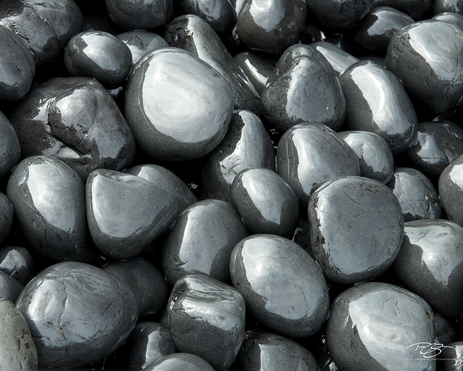 cobbles, cobblestones, black round stones, gun metal stones, gun metal rocks, oregon coast, newport, yaquina head lighthouse, cobble beach, Cobbles, round polished rocks, polished basalt, photo