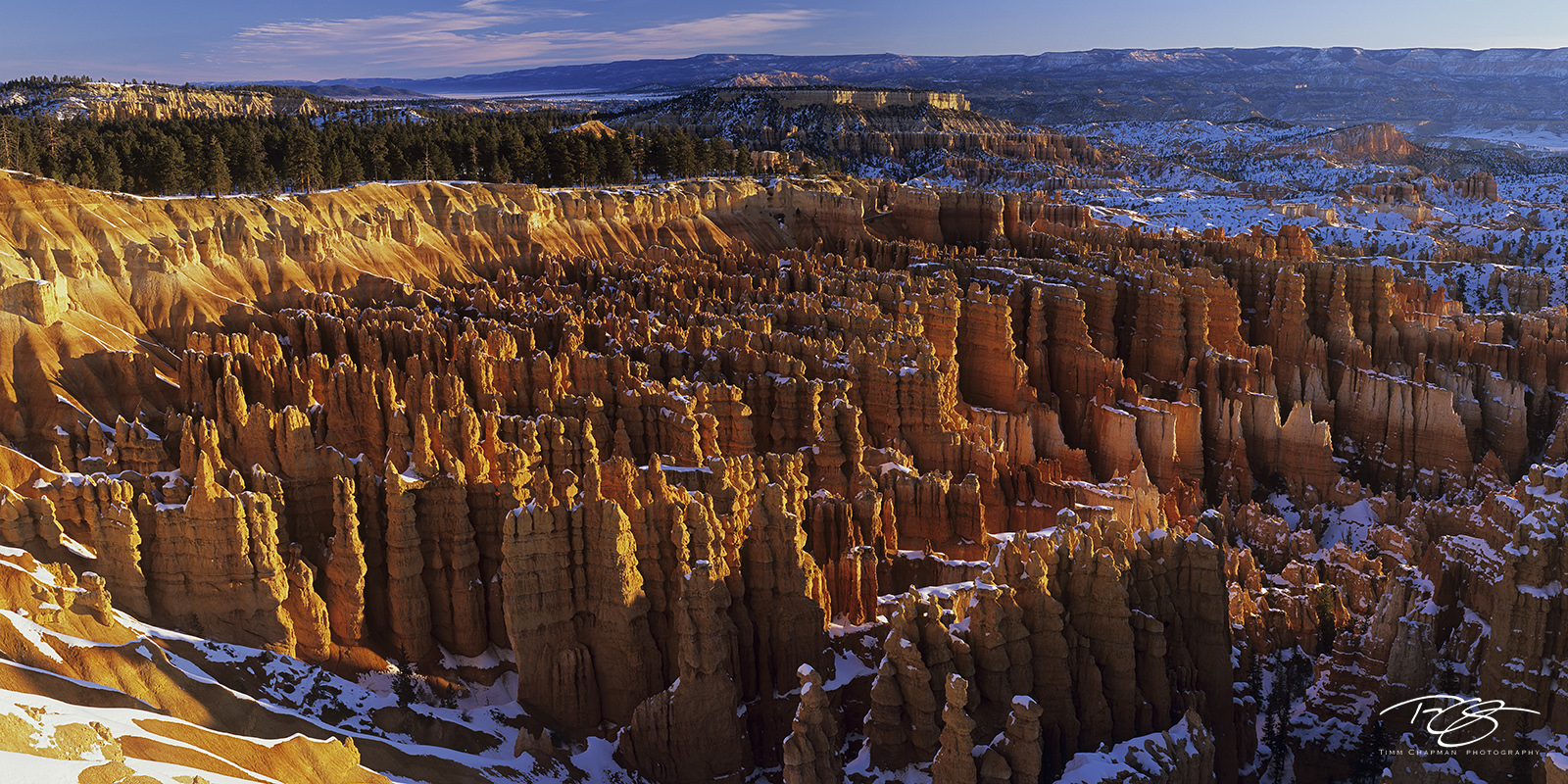 The first light of day casts a warm glow across the Silent City at Bryce Canyon