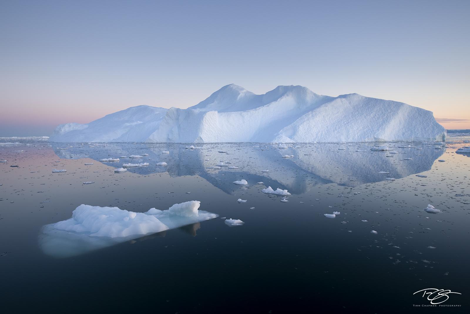 ice; iceberg; disko bay; predawn; dusk; eventide; twilight; icefjord; reflection; pastel sky; blue; pink; purple; iceberg visible underwater, photo