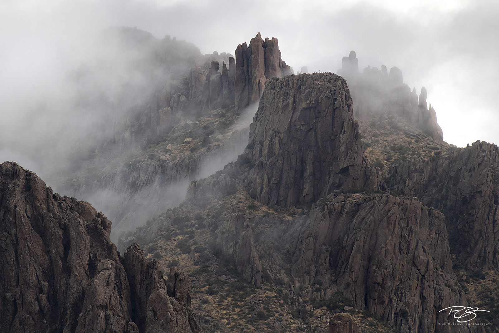 Thick, wet cloud starts to dissipate from the upper reaches of Superstition