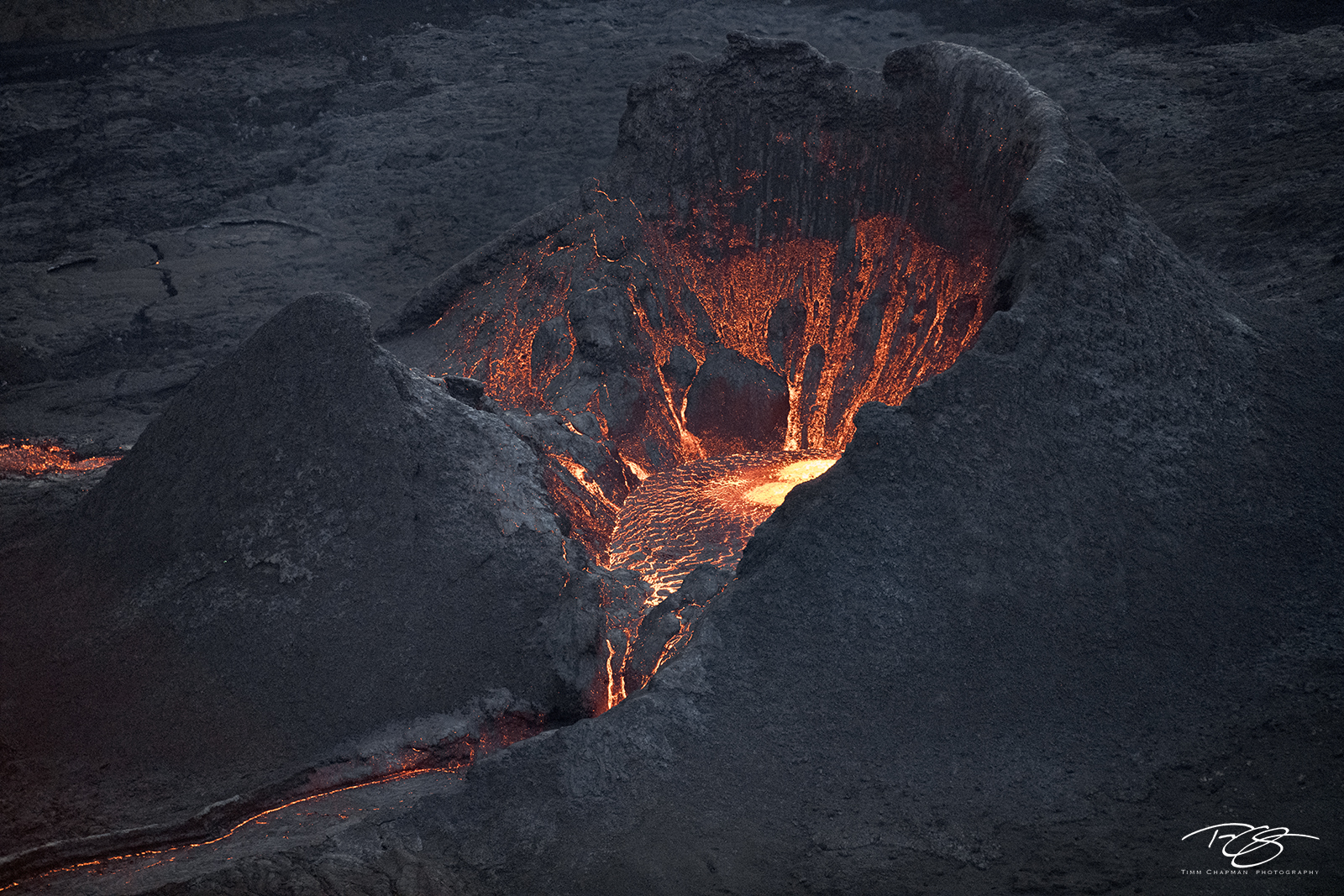 Volcano caldera glowing as magma bubbles to the surface