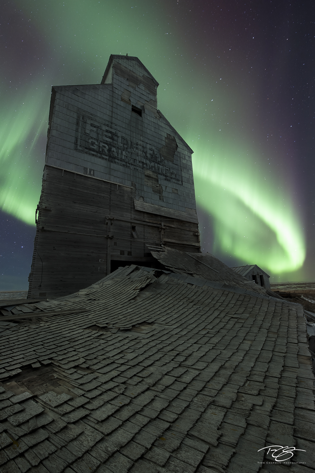 A Century old Federal Elevator is set alight by the swirling skies of the Aurora
