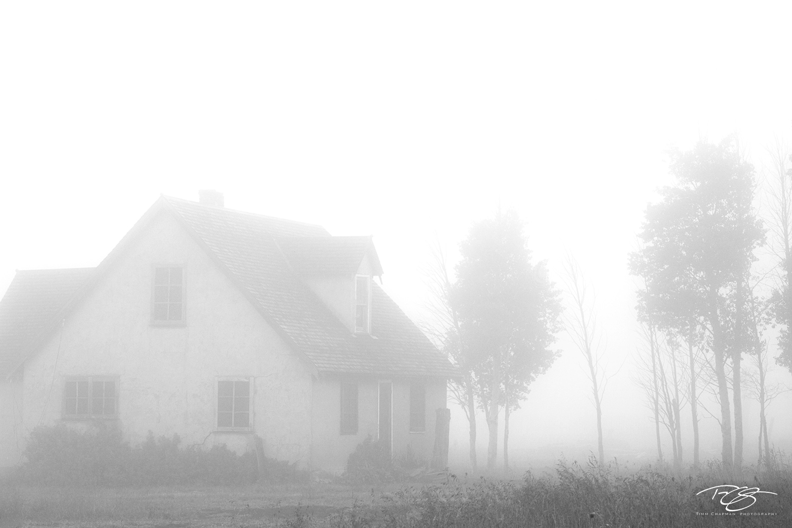 black and white, monochrome, derelict, ghost town, ghost house, foggy, misty, eerie, thick fog, farmhouse, old house, old farm house, Mormon Row, Moulton, Tetons, solace, solitude, misty, quiet, photo