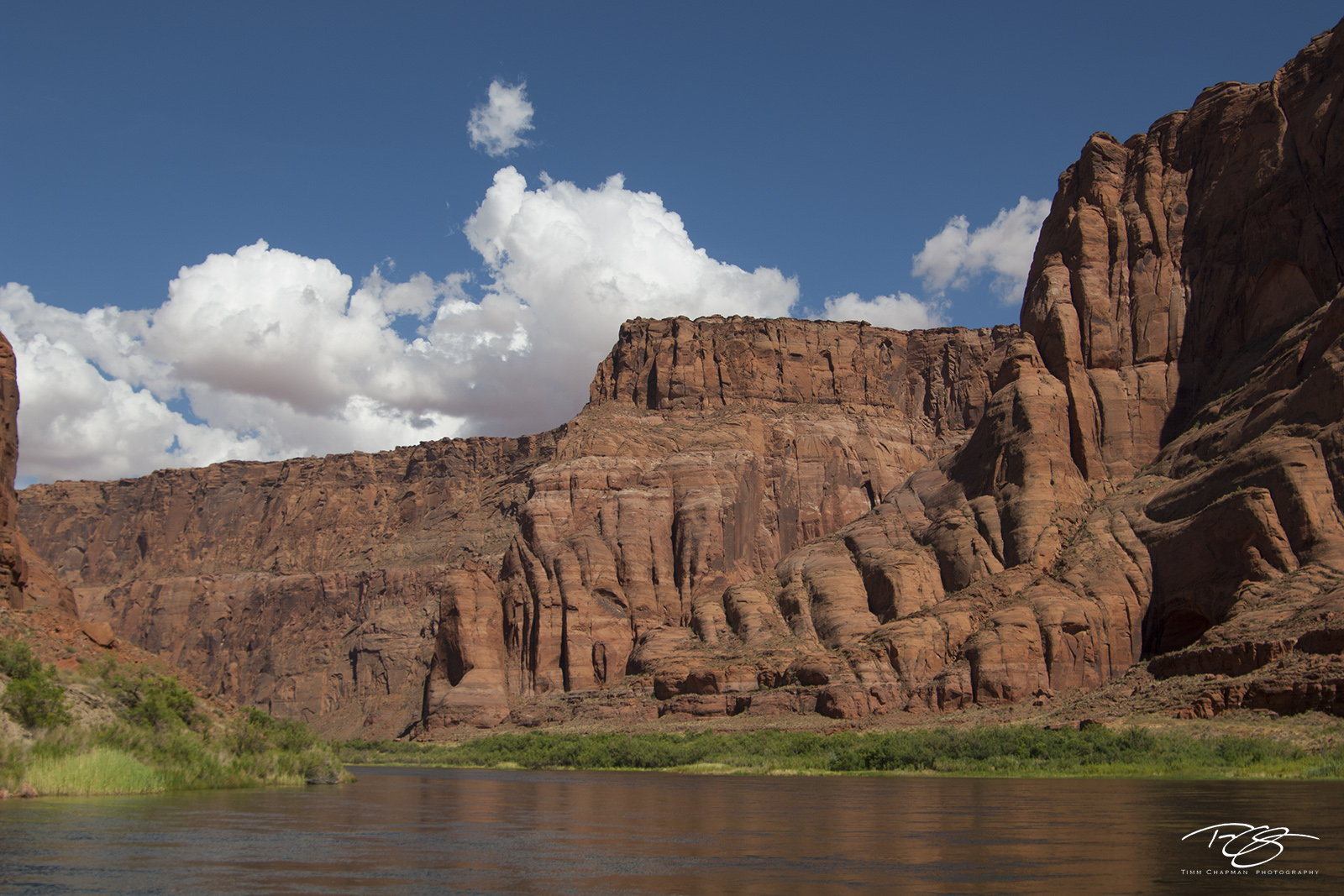 The majestic walls of Glen Canyon tower over the Colorado River