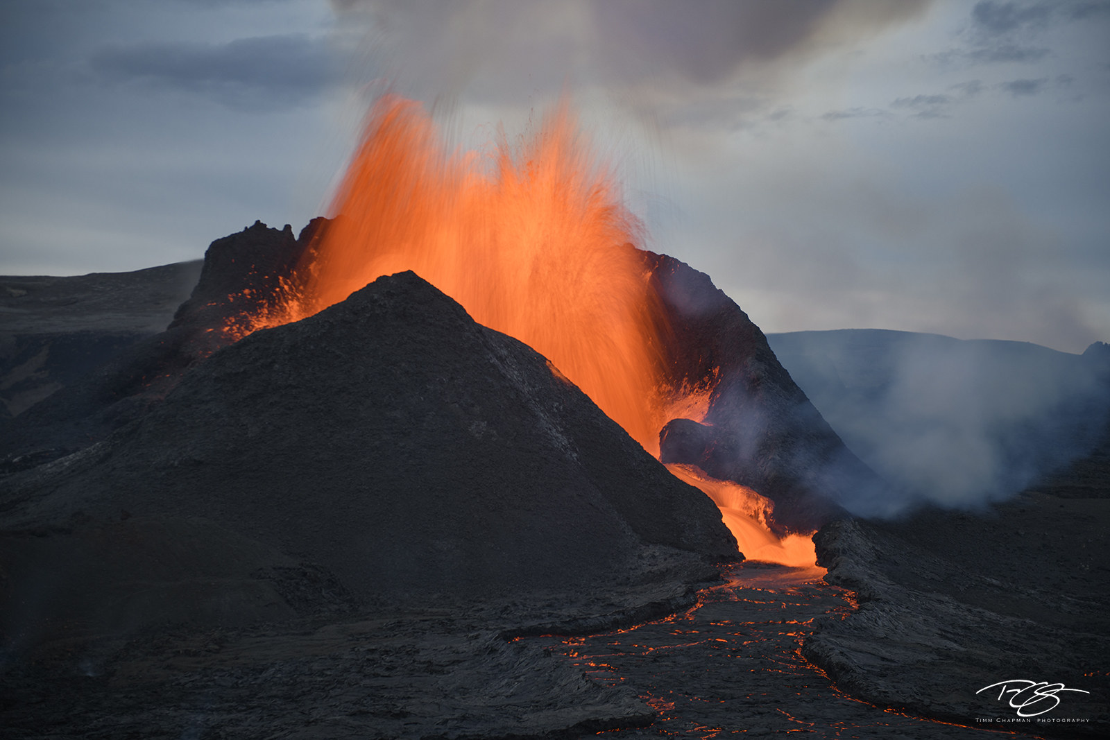 A volcano erupts in a slow motion symphony of molten lava