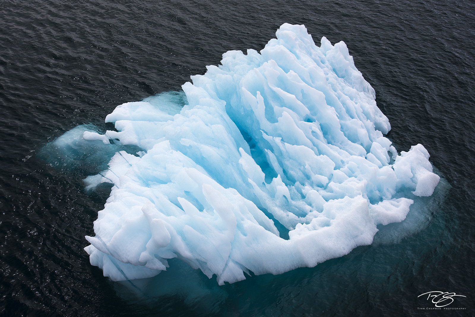ice, iceberg, blue ice, turquoise, aqua, iceberg visible under water, iceberg visible underwater, sculpture, sculpted, photo