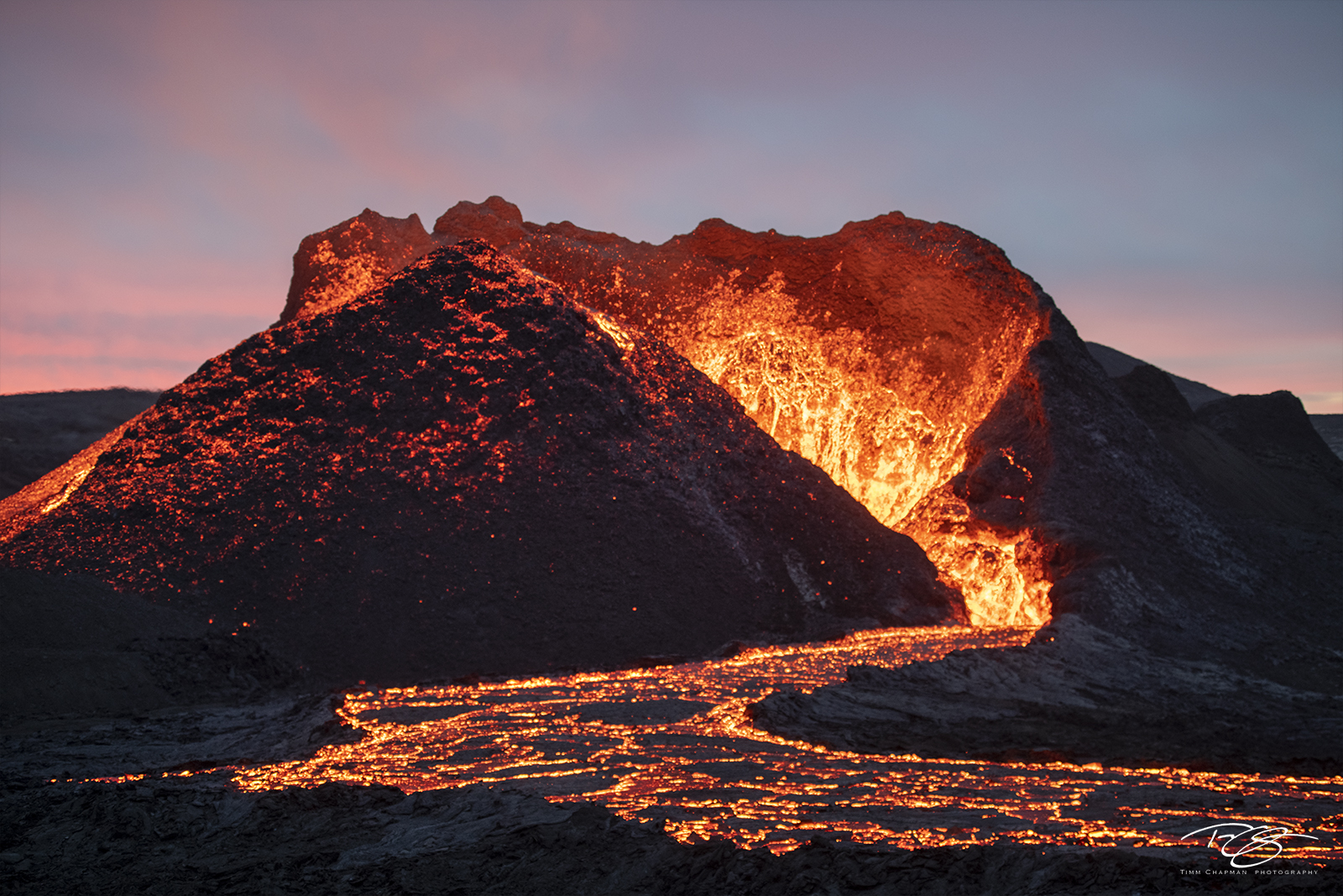 A volcano glows with a coat of fresh lava shortly after an eruption