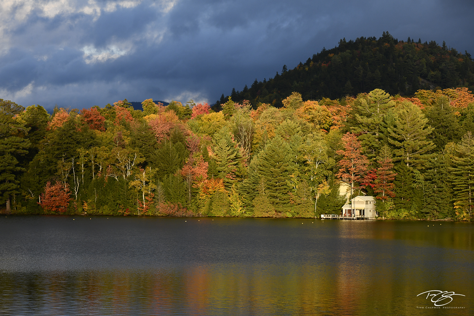 autumn, fall, colour, colours, color, colors, leaves, new england, new york, adirondack mountains, adirondacks, mirror lake, reflection, water, home, house, dramatic light, photo