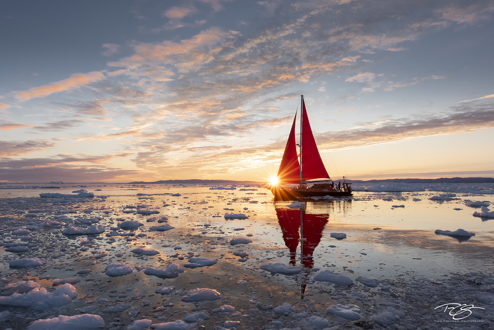 ice; iceberg; disko bay; dusk; twilight; predawn; sunrise; icefjord; ship; sailboat; sailing; schooner; sails; red sails;  scarlet sails, sunburst, yacht, photo