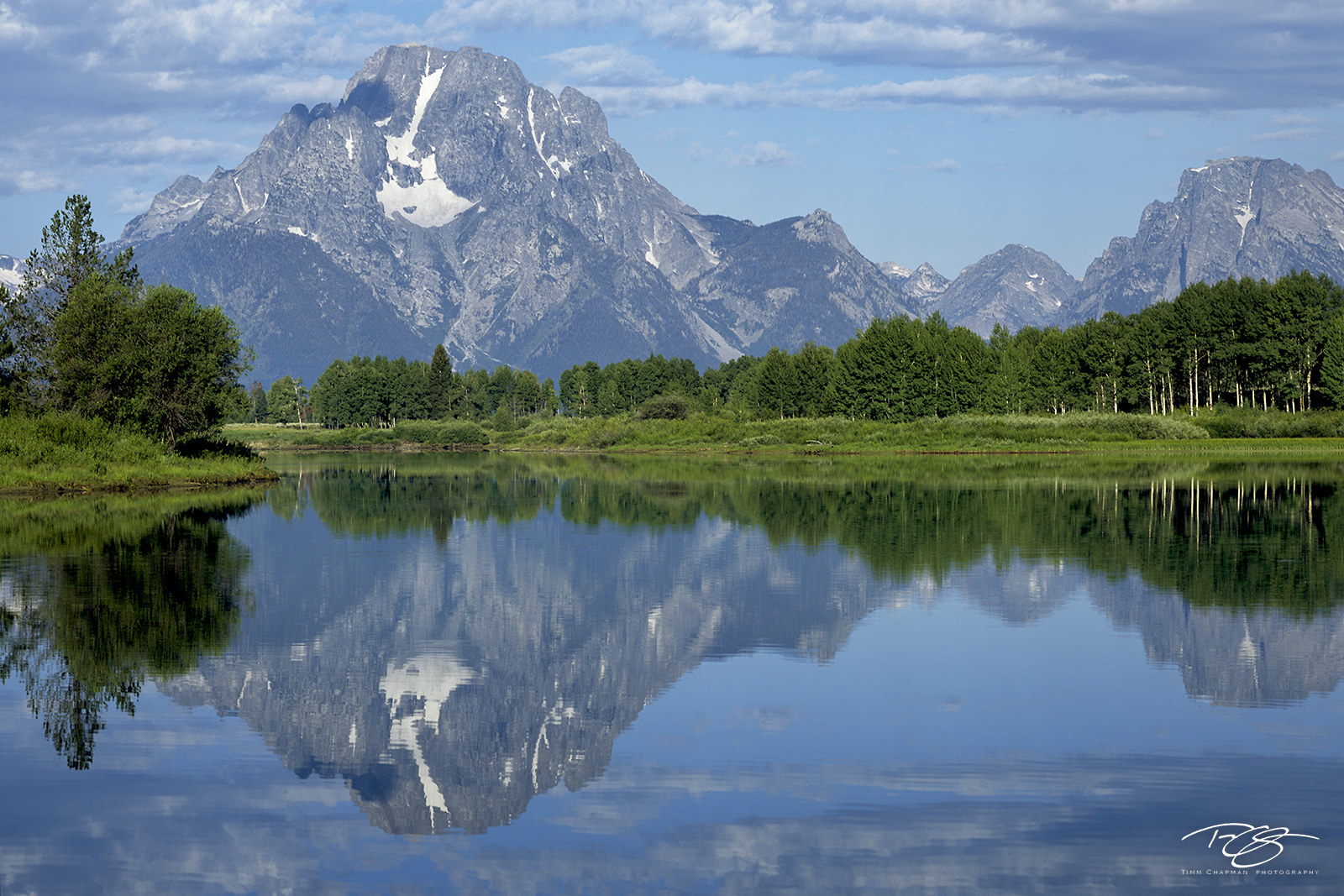 A bend in the Snake River provides a beautiful reflection of the Tetons' Mt Moran