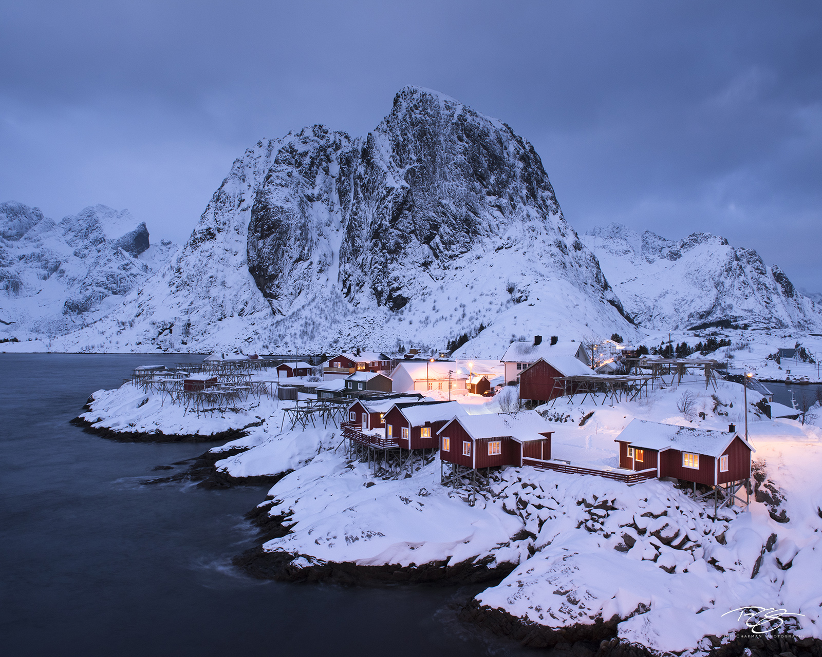 A cold winter's night begins to descend on a small fishing village
