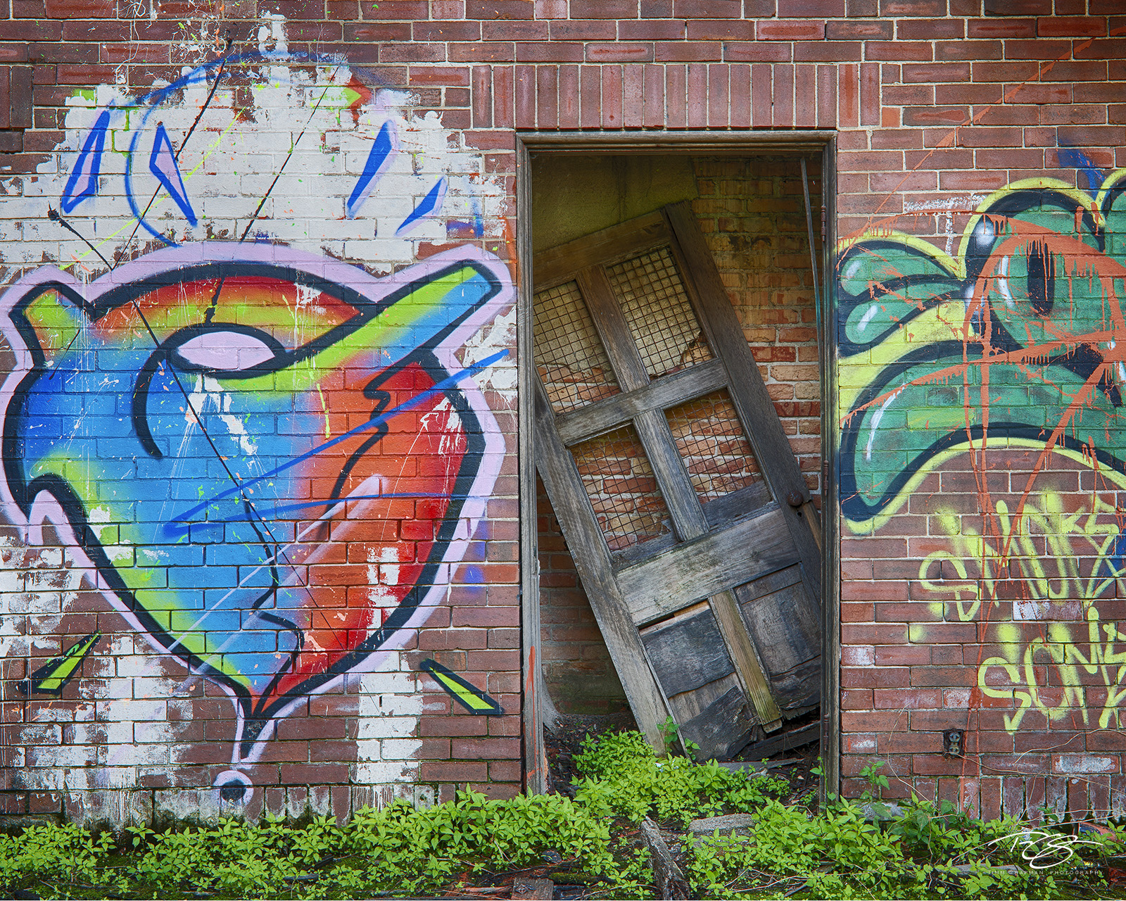 door; brick wall, brick, peeling paint, graffiti, church; abandoned; forgotten; decay; ruin