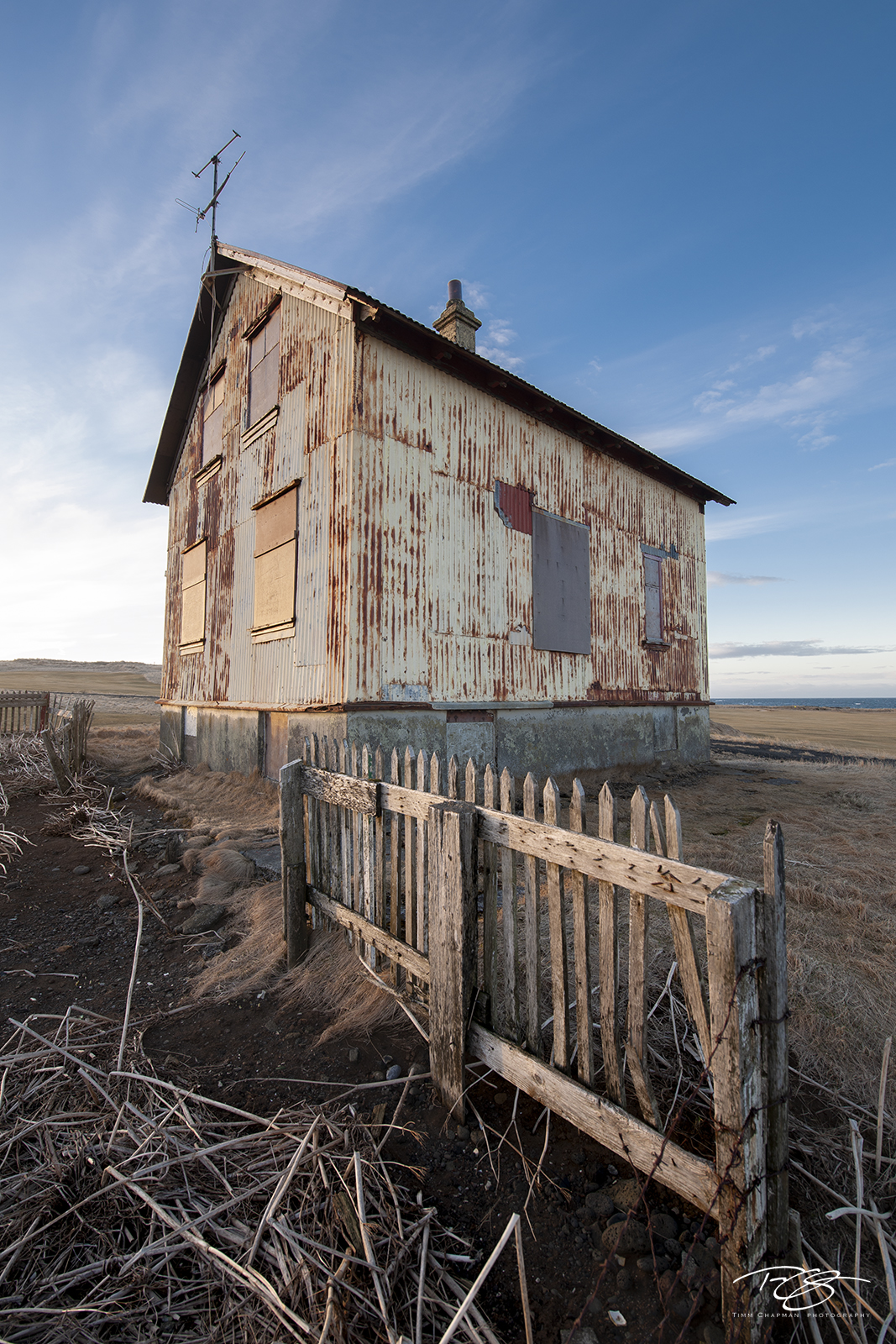 A lonely abandoned farmhouse in Iceland. The salt air is slowly penetrating it's skin, eager to become its new tenant.