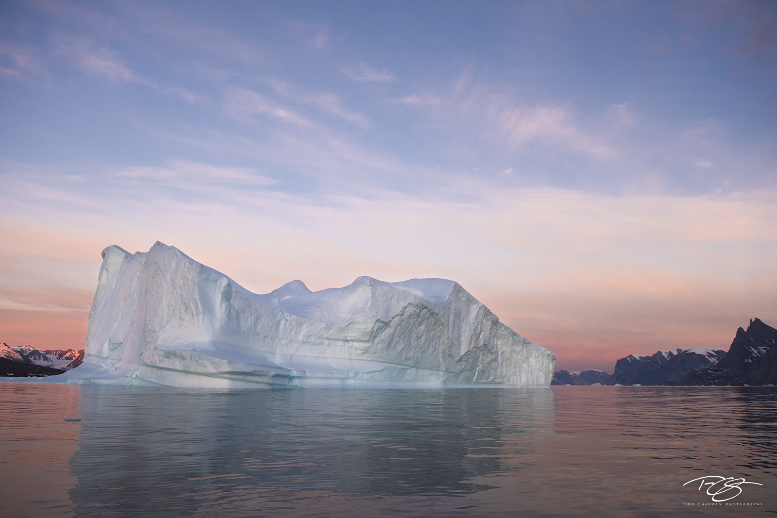 ice; iceberg; reflection; predawn; eventide; twilight; pastel sky; pink sky; alpenglow, dawn, photo