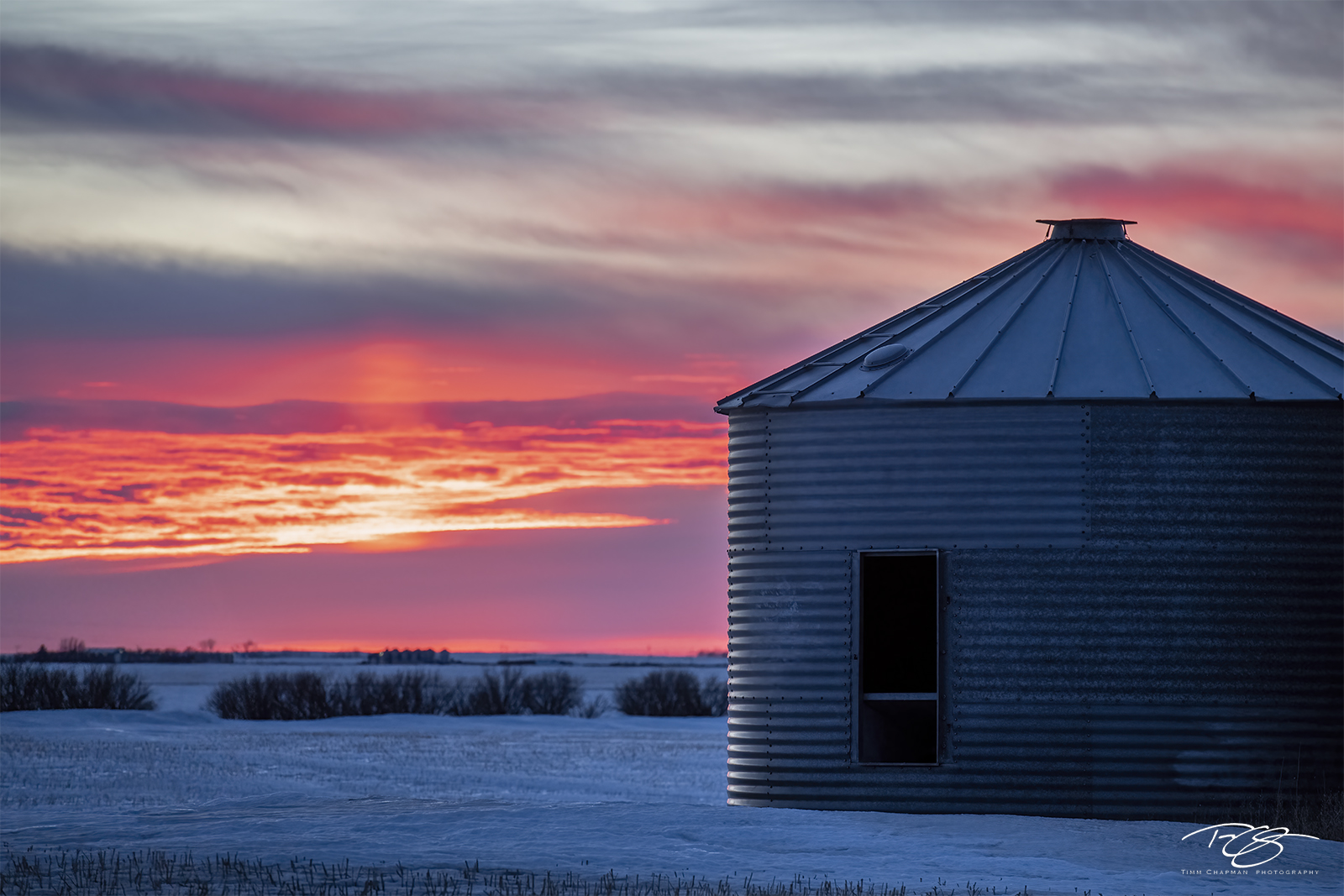 The winter prairie sky erupts in a fiery sunset
