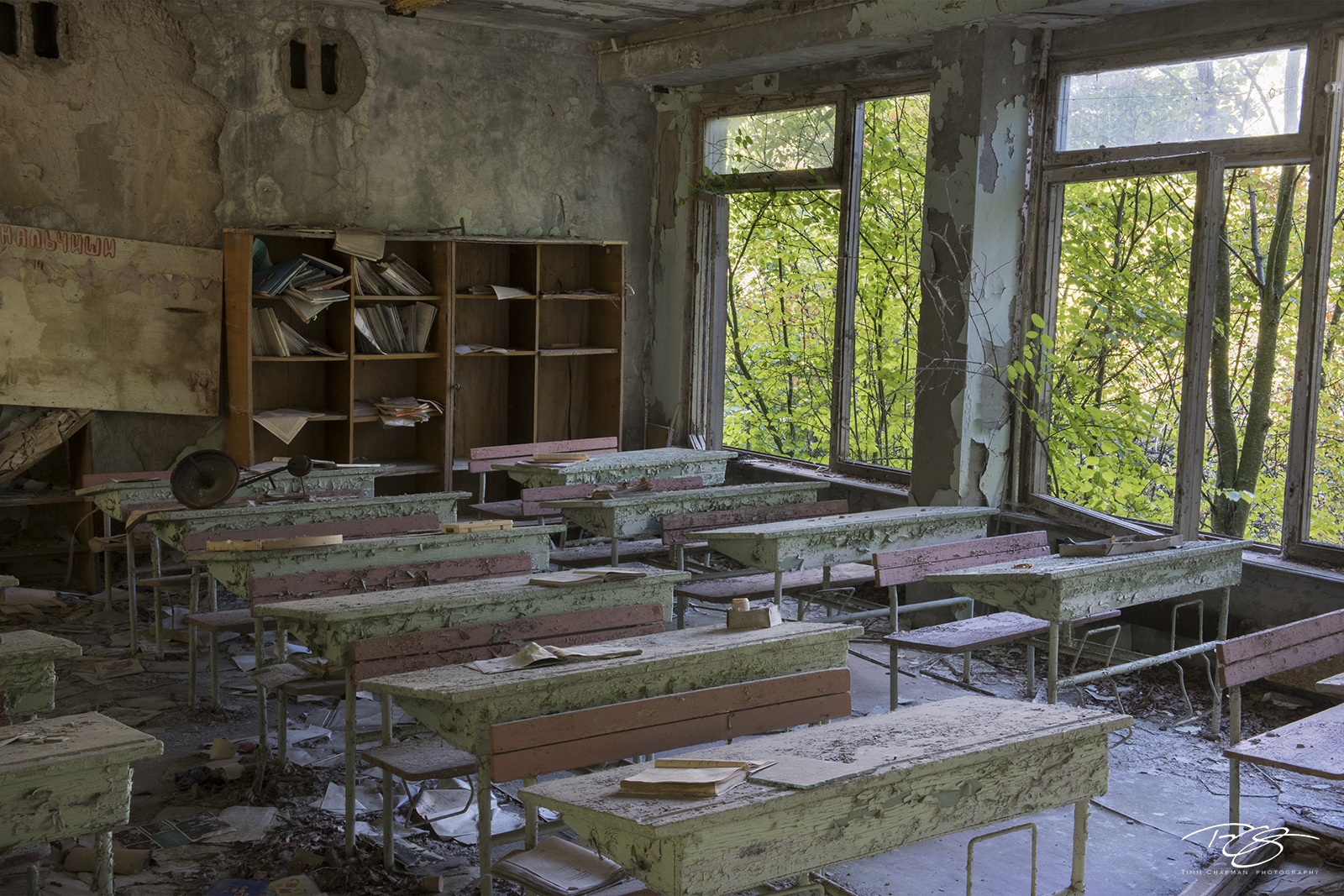 chernobyl, chornobyl, pripyat, exclusion zone, abandoned, forgotten, wasteland, radioactive, decay, classroom, school, class, desk, schoolbook, worn book, well read, dirty book, discarded book, dust, photo