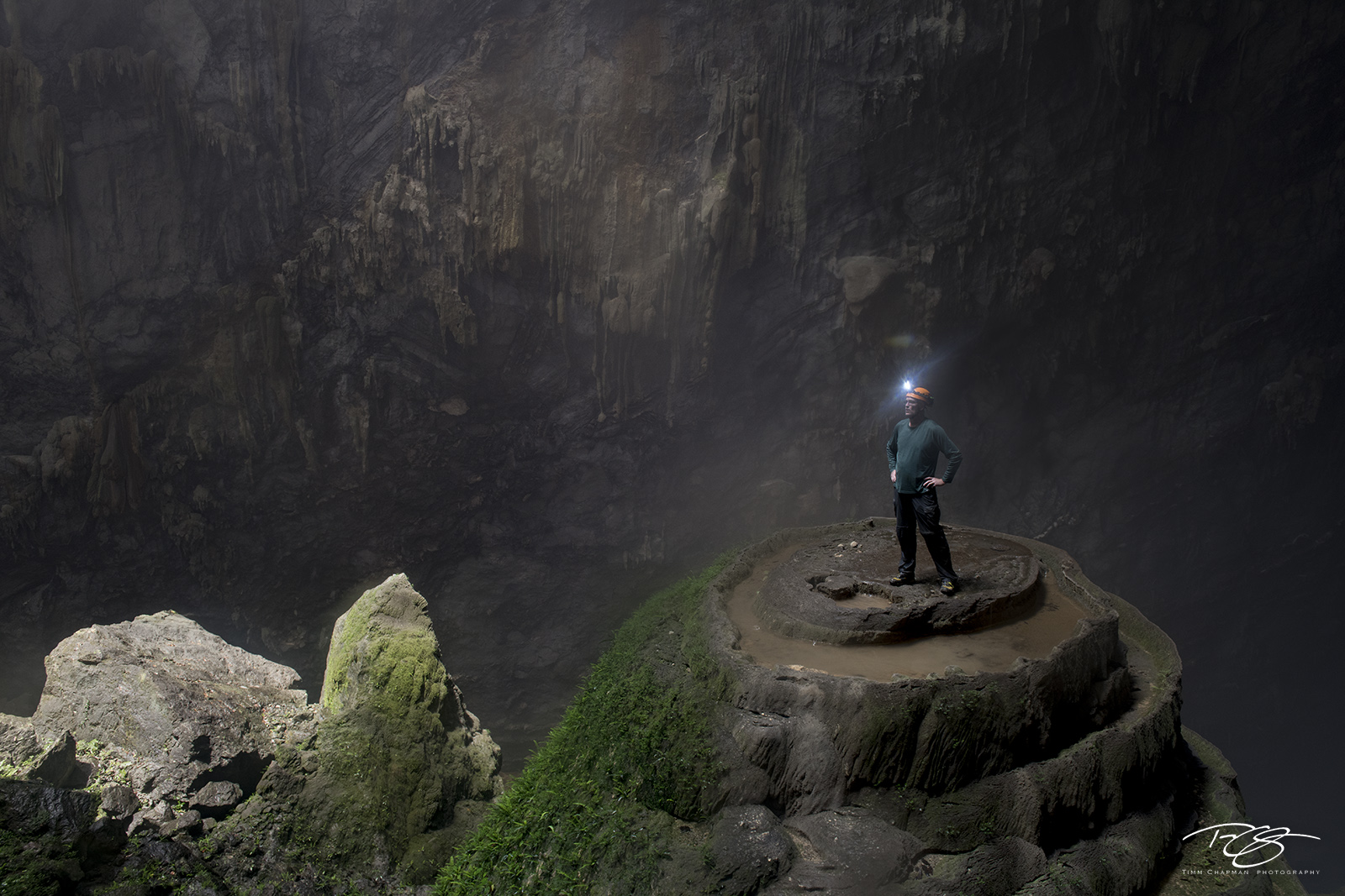 A cave explorer perched atop a 75 metre stalagmite marvels at the immensity of Hang Son Ðoòng - the world's largest cave