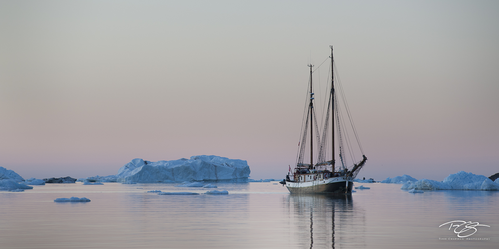The Donna Wood, a near hundred year old sailing ship. navigates around icebergs in search of safe harbour at 1:30 in the morning...