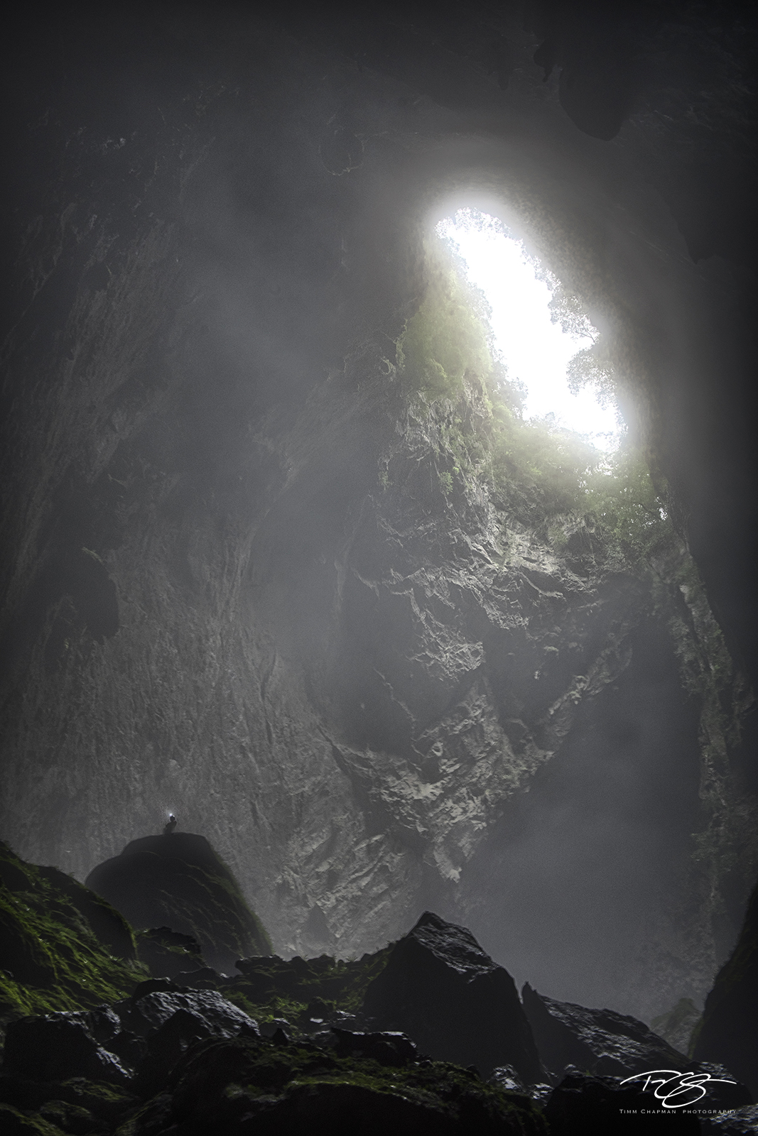 A lone explorer is dwarfed by the immensity of Hang Son Ðoòng - the world's largest cave