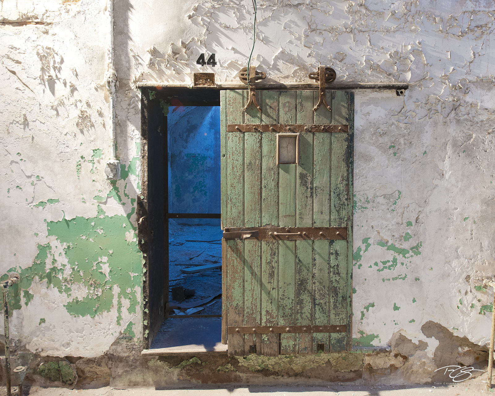cell, cell block, peeling paint, paint, green, blue, reclamation, collapse, jail, prison, door, penitentiary, eastern state, corridor, dingy, abandoned, debris, old, dark