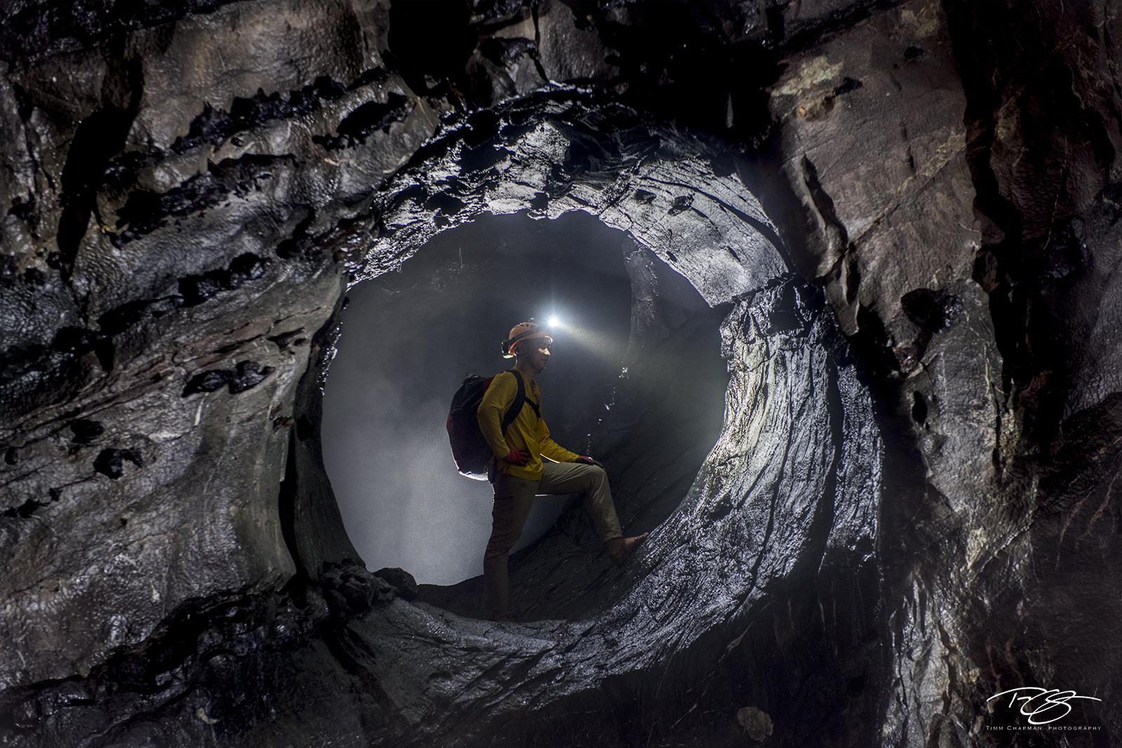 A naturral circular hole deep inside Hang Son Ðoòng affords a cave explorer a moment as a secret agent