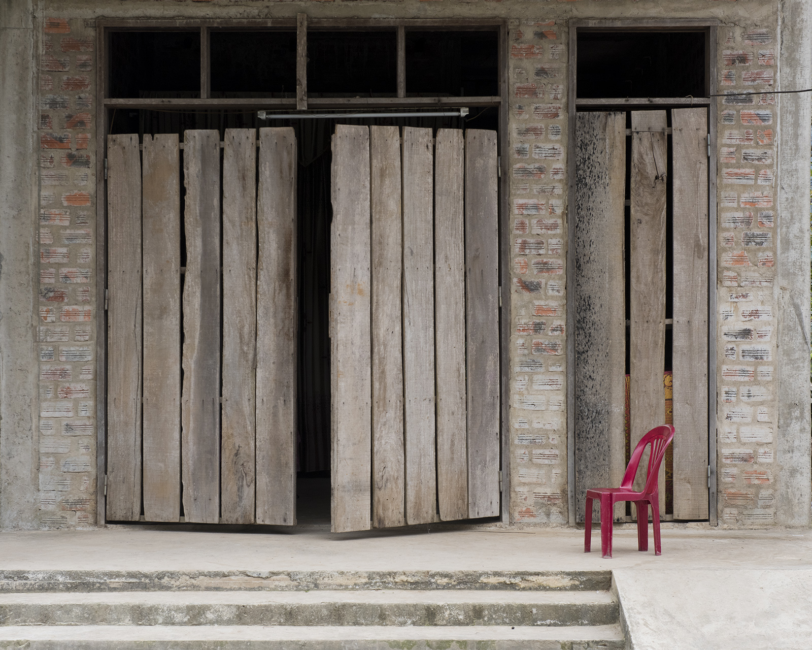 vietnam, door, chair, red chair, phong nha, worn, rustic, barnboard, brick, solitude, alone