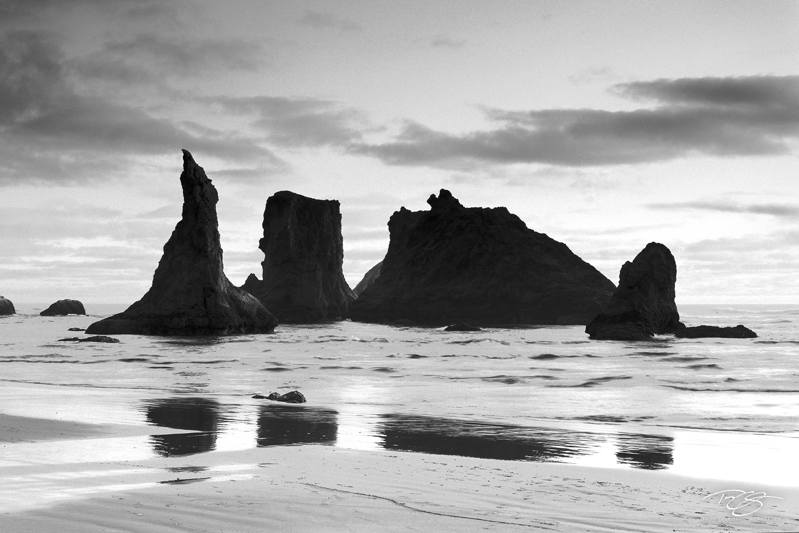 The iconic sea stacks of Bandon Beach silhouetted in the surf