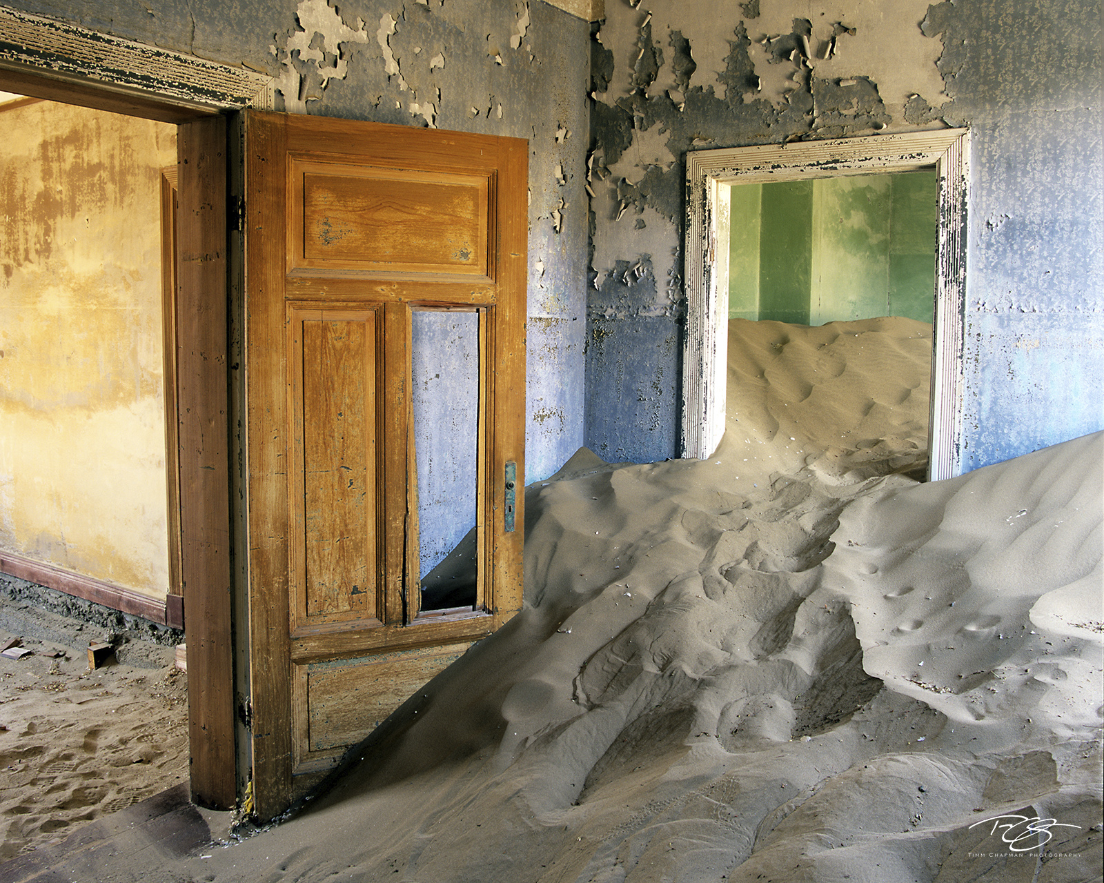 namibia, sands of time, namib desert, desert, sand, doors, door, doorway, dunes, ghost town, kolmanskop, kolmanskuppe, luderitz, abandoned, town, diamond mining, flooded, homes, home, peeling paint, photo