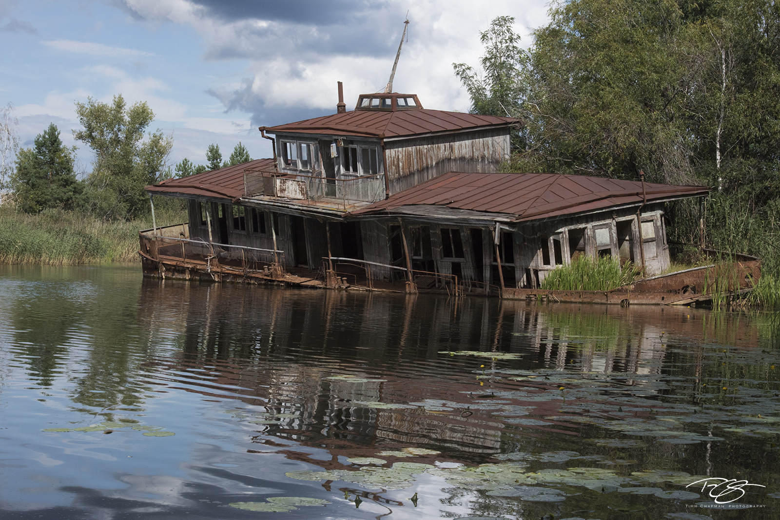 chernobyl, chornobyl, pripyat, exclusion zone, abandoned, forgotten, wasteland, radioactive, decay, peeling paint, pripyat river, boathouse, ship, boat, passenger ship, ferry, sinking ship, reflection, photo