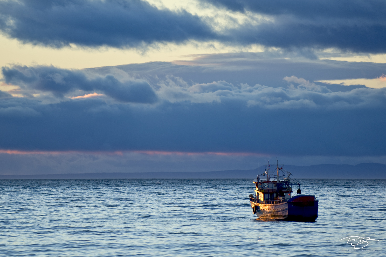 solitude, stormy skies, fishing trawler, fishermen, sunrise, golden light, fishing boat, treacherous seas, calm before the storm, uncertainty, don't know what tomorrow brings, patagonia, punta arenas,, photo