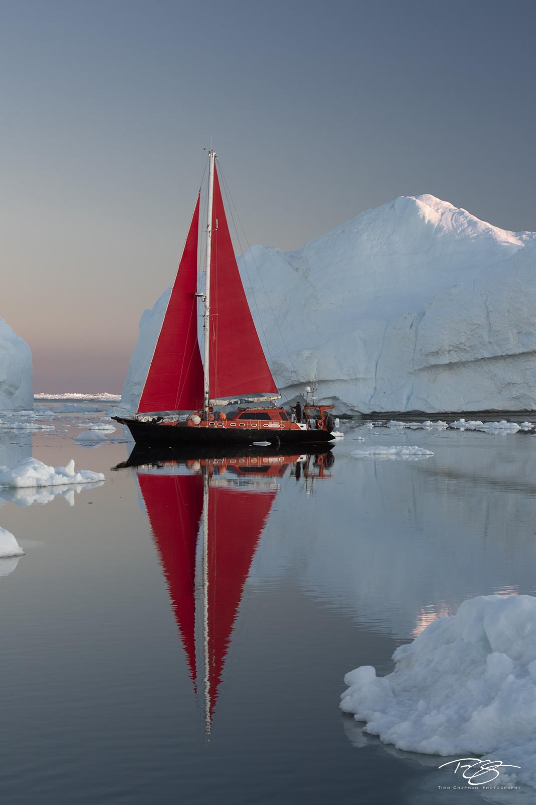 reflection; golden light; golden hour; pastel sky; scarlet sails, ship; sailboat; sailing; red sails; schooner, ice; iceberg; disko bay; dawn; sunrise; early morning, yacht, photo