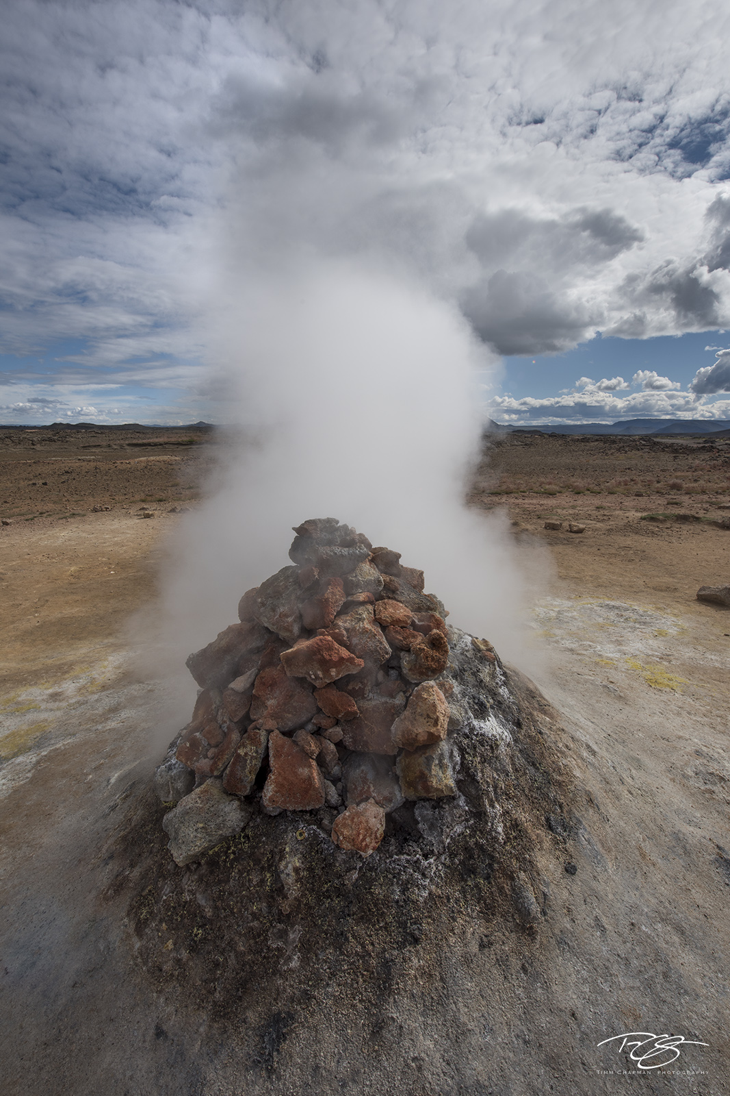 Steam is furiously released from a geothermal vent in North Iceland